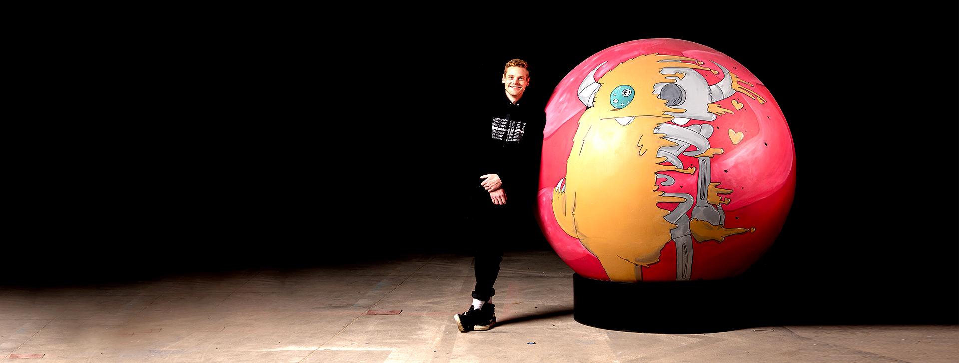 young man with giant bingo ball