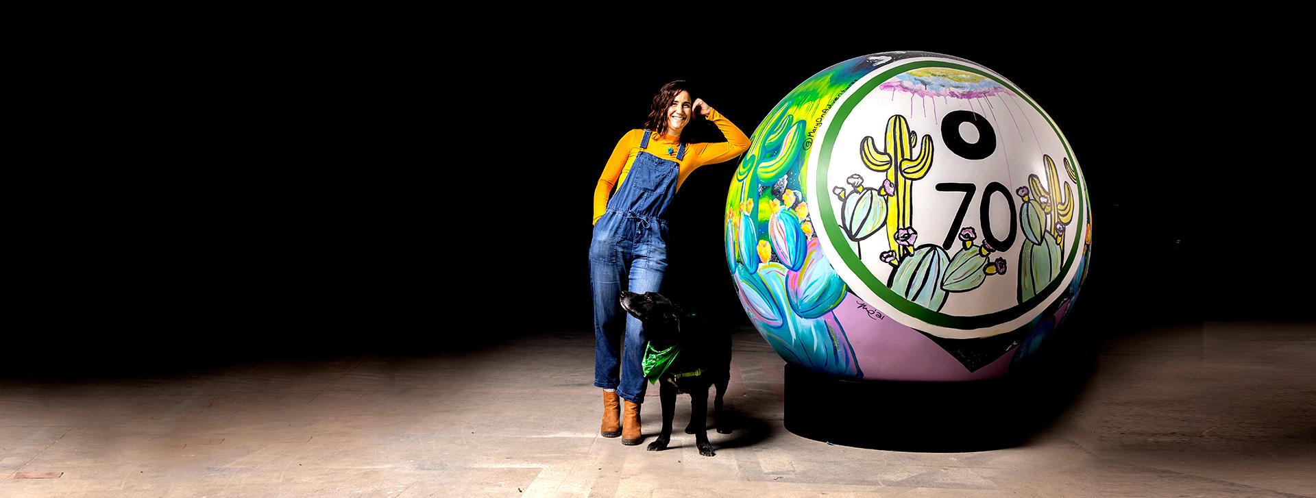 woman and dog with giant bingo ball