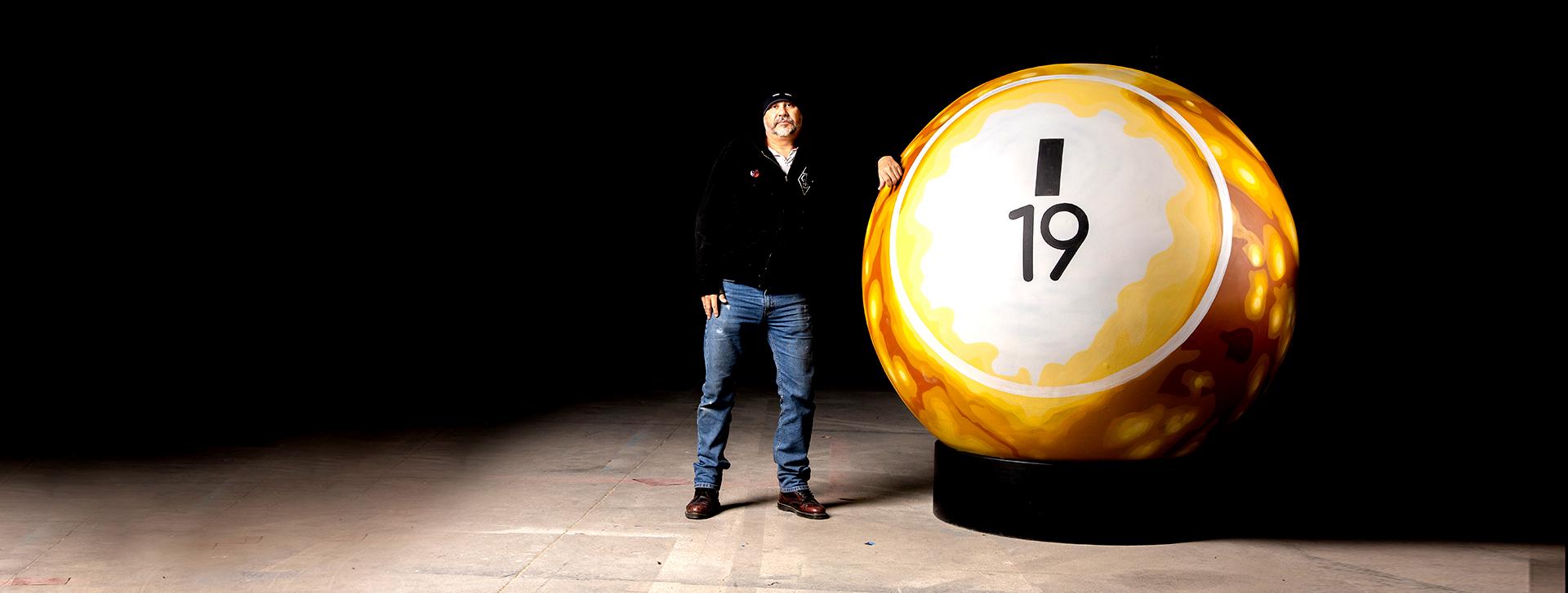 man with giant bingo ball